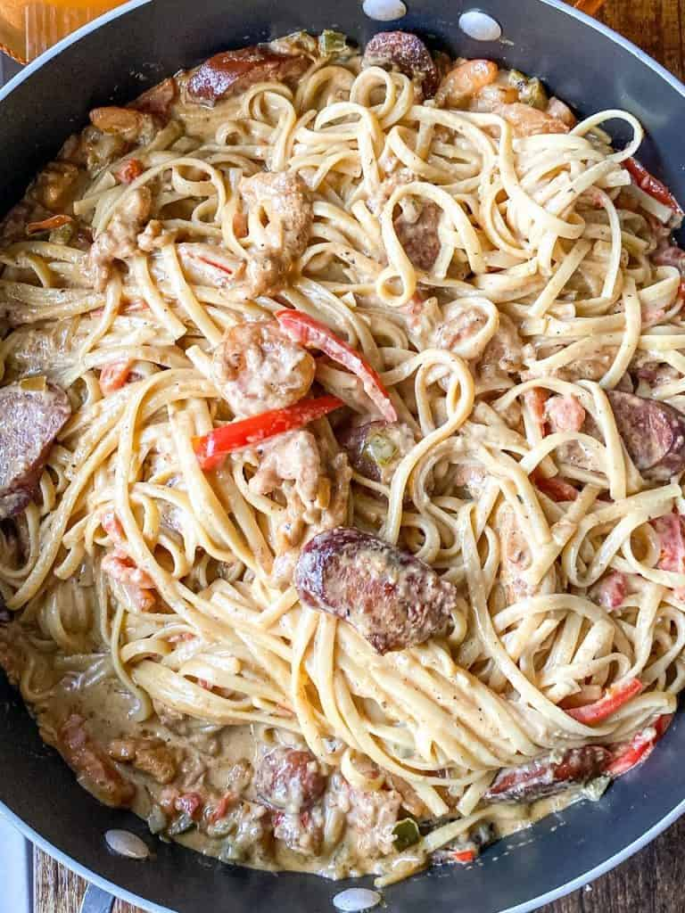 Creamy Rasta Pasta with Smoked Sausage and Chicken shown above head in the pan