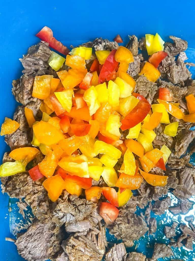 meat and peppers in a bowl for Cheesy Taco Stuffed Peppers with Beef