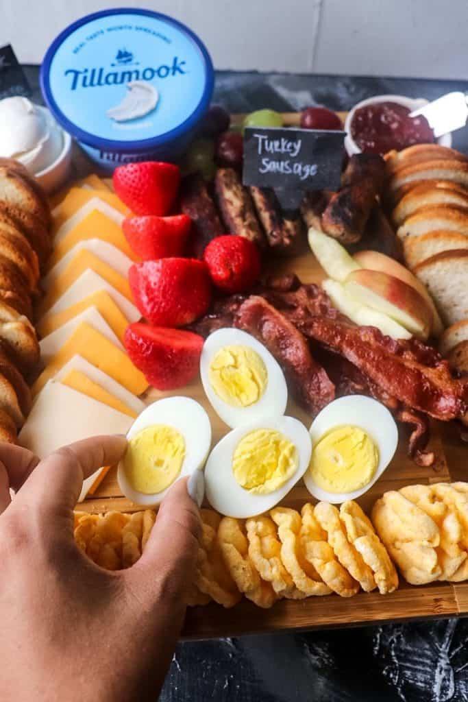 placing egg on Breakfast Charcuterie Board