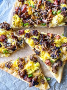 slices of breakfast pizza at a side angle