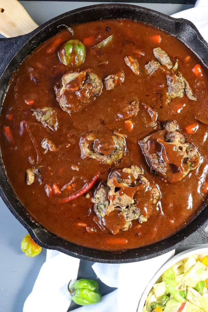 gravy and oxtails in the skillet