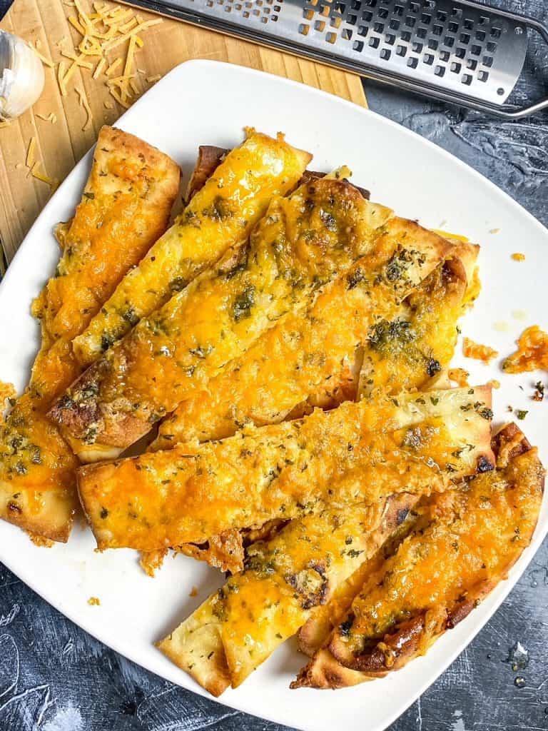 Slice of Air Fryer Cheesy Garlic Naan Bread