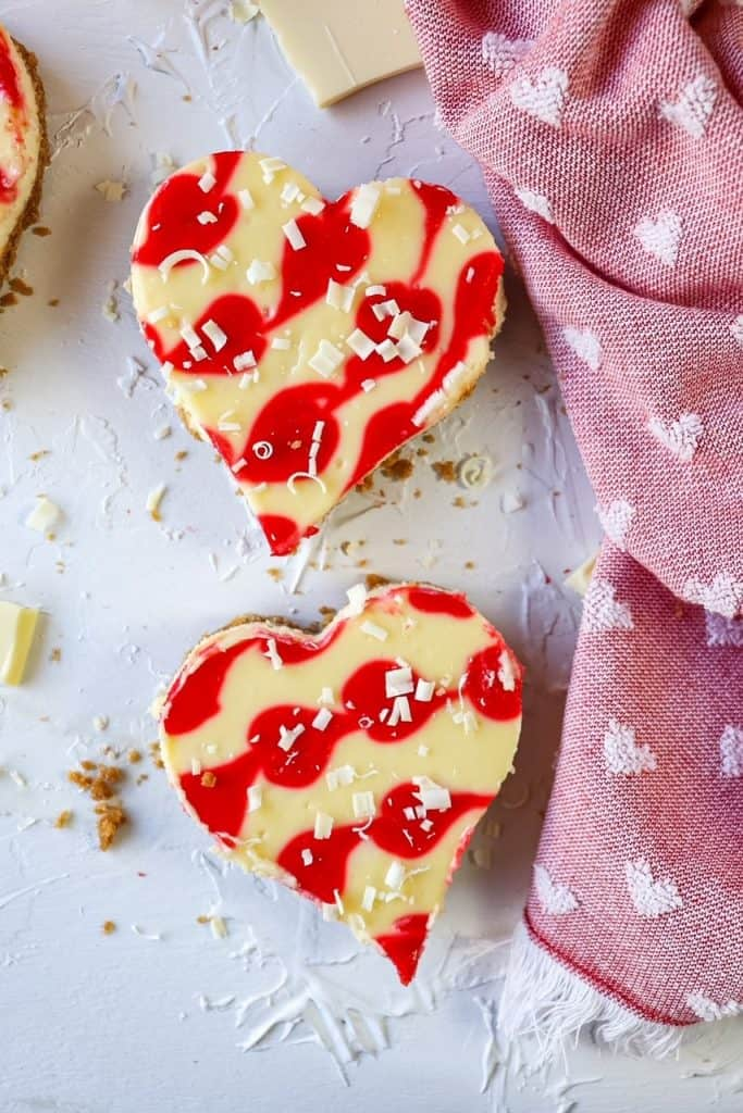 heart shaped cheesecakes on a board