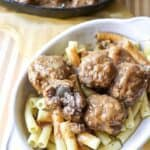 close up of swedish meatballs over pasta