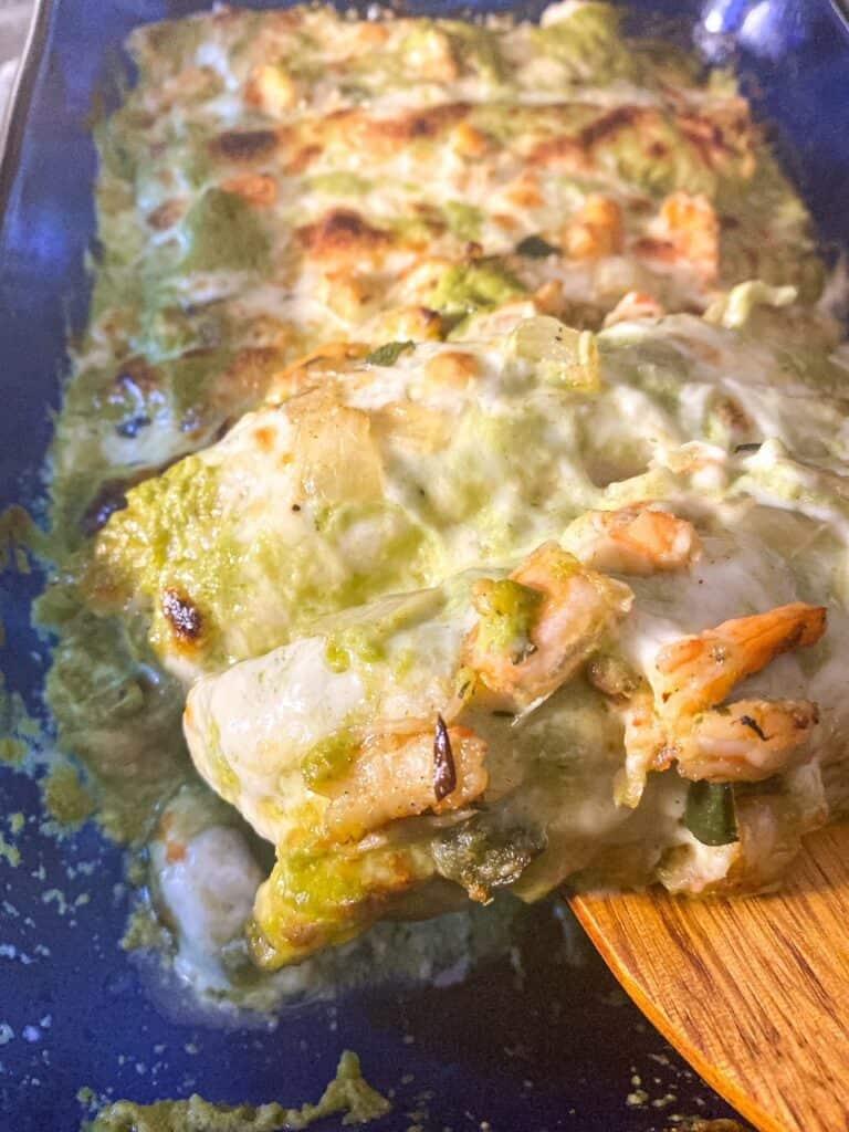 close up of shrimp enchiladas showing the cheese and shrimp
