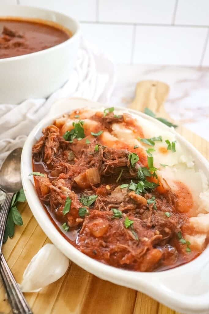 side angle of beef ragu in a dish