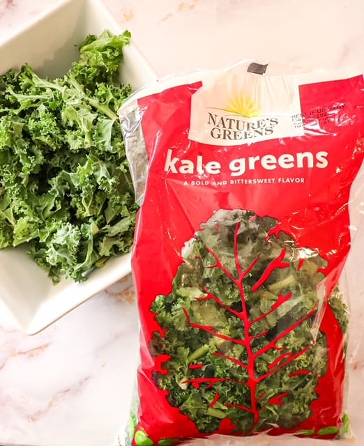 kale in a bowl with a bag of Nature's Greens sitting next to it
