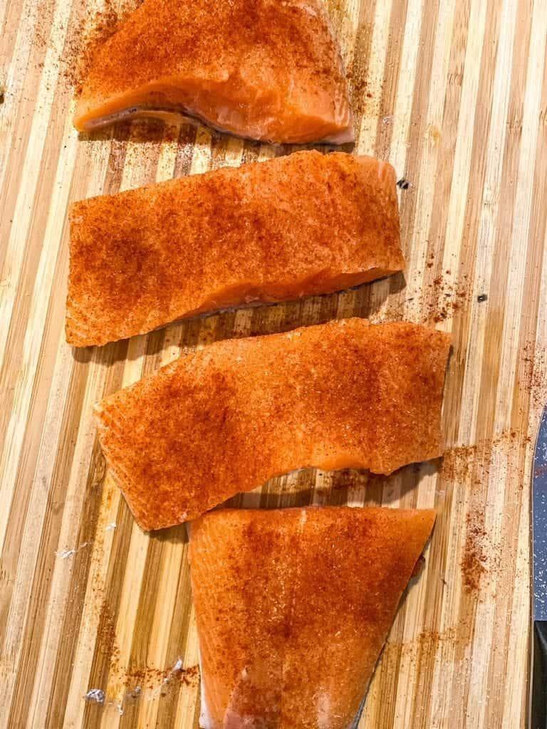 salmon being seasoned